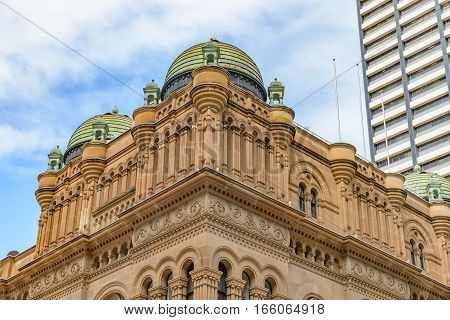 Contrasting architectural styles between the Queen Victoria Building and modern tower block in George Street Sydney Australia.