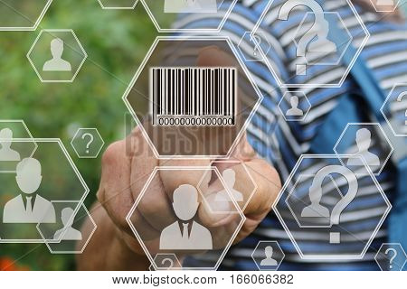 Farmer businessman  clicks barcode product network icon on the touch screen the web network .Tanned hands, male hands of an elderly person.