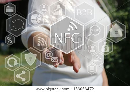 The businesswoman clicks on the NFC  icon on the touch screen the web network.
