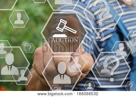 Farmer businessman clicks on the button online auctions on the touch screen the web network.
