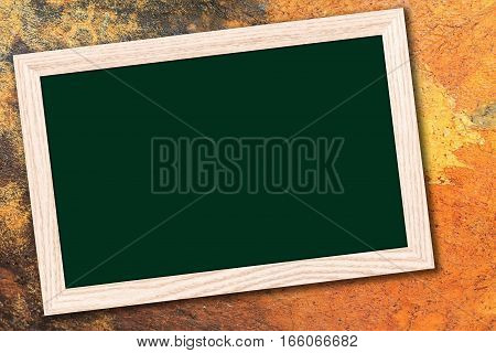 Chalkboard or Empty bulletin board with a wooden frame on cement wall background with copy space for text or image.