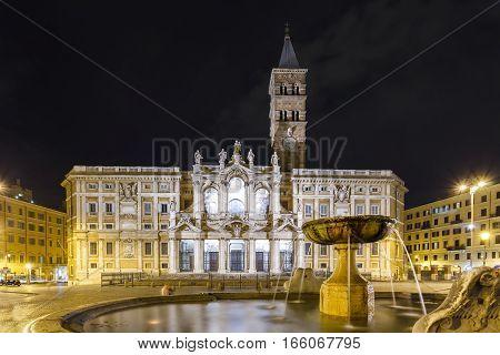 Basilica di Santa Maria Maggiore, in the light of lanterns at night in Rome, Italy