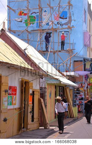RODRIGUES ISLAND, MAURITIUS - NOVEMBER 10, 2012: Creole houses in Port Mathurin streets with local wooden scaffolding