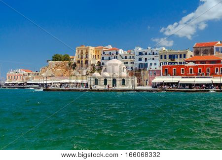 View of the embankment and the mosque Kucuk Hasan Pasha in the Venetian harbor. Crete. Greece.