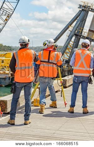 SYDNEY AUSTRALIA - OCTOBER 13, 2016 : A group of civil engineers working at King Street Wharf in Pyrmont bay central Sydney.