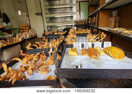 Rethymnon Island Crete Greece - June 23 2016: Traditional Greece bakery with fresh and tasty muffins pastry and bread on the street of the old town's part of city Rethymnon