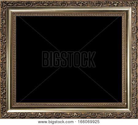 Decorative vintage empty golden painted wood picture frame on black background.