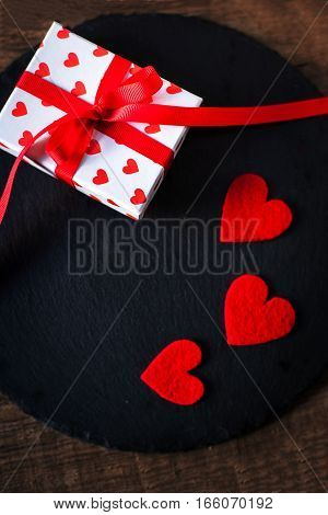 Valentine's Day card with red hearts gift box with red ribbon and place for text. Valentines Day concept Background for design