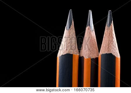Closeup Of Sharp Pencil. Pencil Point Close-up On Black Background. .