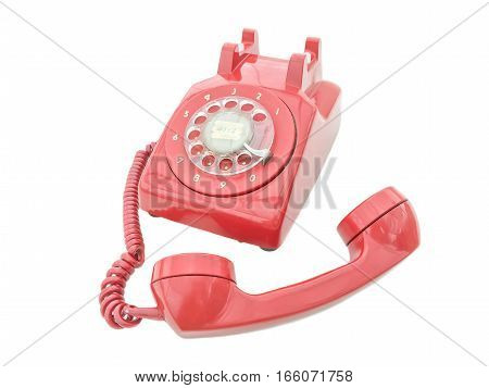 vintage open handset red telephone which has classic number