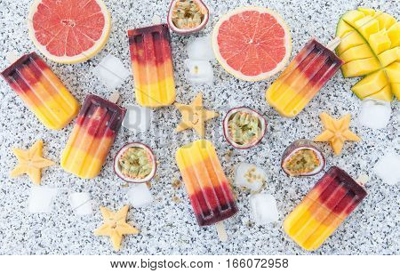 Homemade frozen popsicles with fresh exotic fruits
