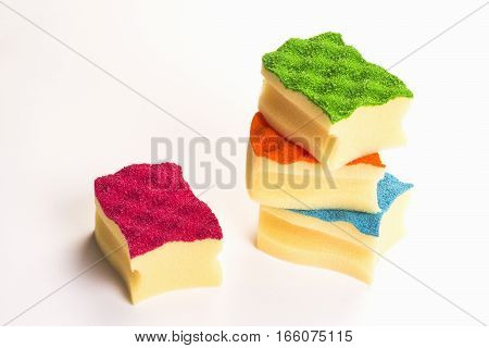 Colorful sponges for cleaning are on white background.