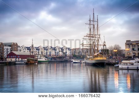 Ships docked near Bristol's port on a cloudy day