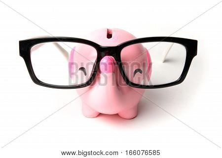 Pink elephant piggy bank with glasses isolated on a white background.