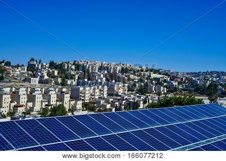 solar panels on the background of the city of Jerusalem