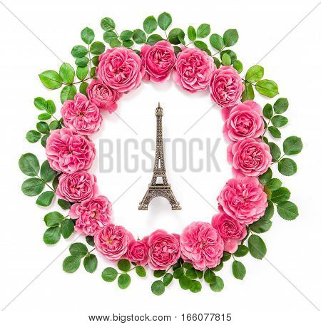 Pink rose flowers with Eiffel tower from Paris. Roses with green leaves isolated on white background. Beautiful flower head wreath