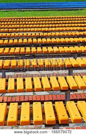 Bright yellow and blue seats in rows