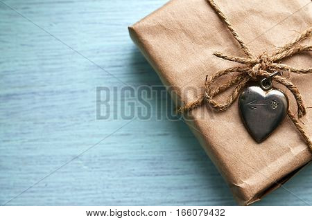 Valentines Day gift with vintage silver heart on a blue wooden background.Valentine's Day background.Saint Valentine's Day or Love concept.Copy space.Selective focus.