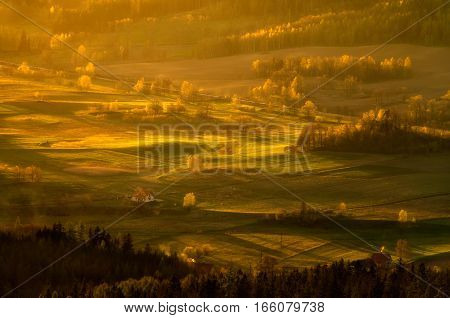 Sunrise at Sudety mountains fields and trees Poland