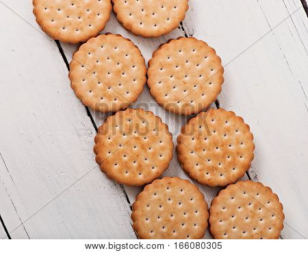 Tasty baked cookies on old wooden background.