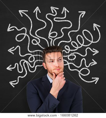 Confused young businessman on Chalkboard Background Working