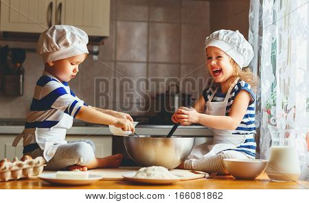 happy family funny kids are preparing the dough bake cookies in the kitchen