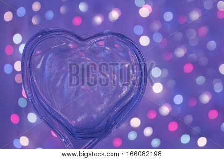 Transparent heart shape on color background. No people