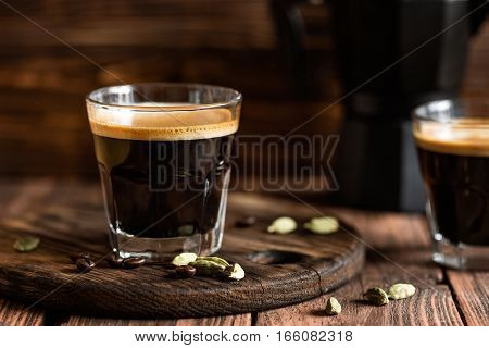coffee drink on wooden background close up