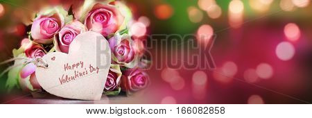 Happy valentines day panorama with a bouquet of rose and bokeh for a greeting card