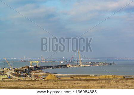TUZLA TAMAN PENINSULA RUSSIA - JANUARY 04.2017: construction of a bridge across the Kerch Strait from the Taman.