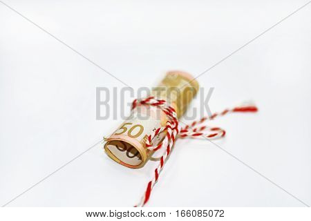 Abstract photo of euro money. Bundle of 50 euros with a ribbon