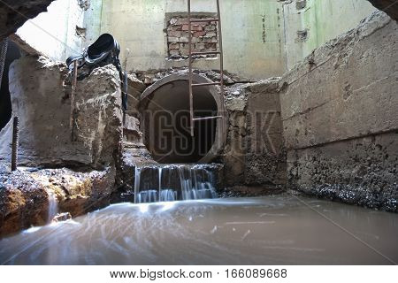 Water is flowing in sewage collector deep underground in Voronezh
