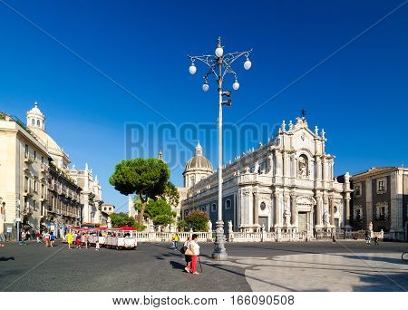 Catania, Italy - September 13, 2015: Piazza Duomo or Cathedral Square with Cathedral of Santa Agatha - Catania duomo in Catania, Sicily, Italy