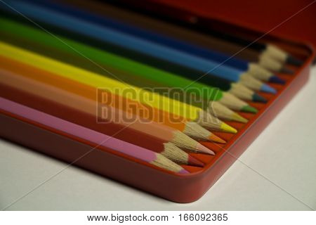 Colored pencils for drawing. New pencils in a box. Horizontal picture.