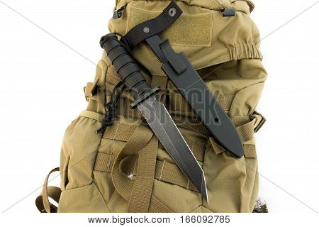 Combat knife on sand military back. Military