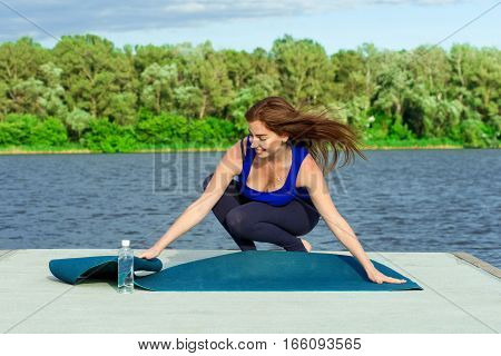 Young Woman Doing Yoga Exercise On Mat 41