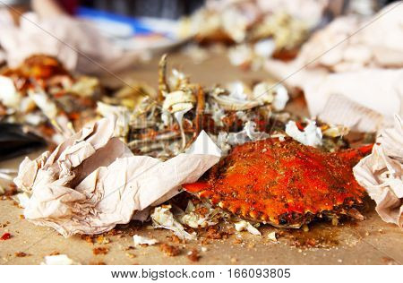 The remains of the tasty Baltimore crabs on the table with napkins