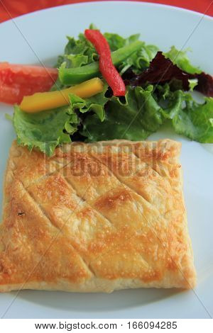 Goat cheese in puff pastry with lettuce French appetizer