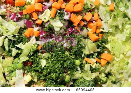 Colorful healthy salad ingredients on table as background
