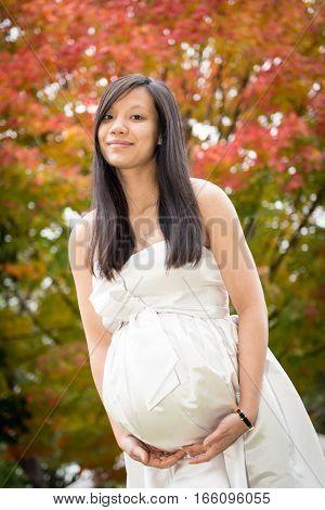 Pregnant lady in the fall season maternity photo