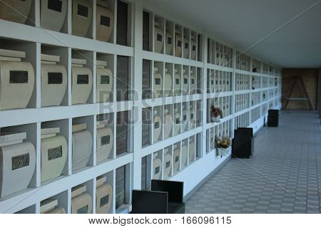Urns with ashes in a columbarium wall