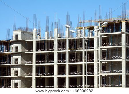 Industrial building construction frames over cloudless blue sky