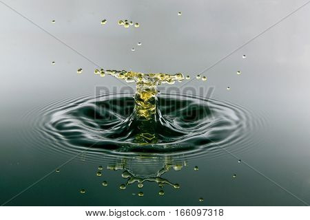 Falling drops of water. Splash effect after collision a falling drops with water Surface