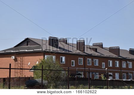 Multi-storey Building With A Roof Made Of Steel Sheets.