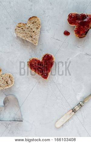 Making Heart Shaped Toast with Strawberry Jam for Valentine's Day Breakfast