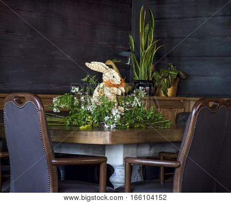 Easter bunny in flowers on gray background