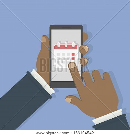 Callendar in smartphone. Man holds phone with callendar on the screen. Concept of agenda and reminder.
