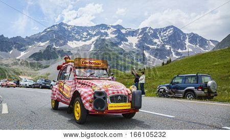 Col du Lautaret France - July 19 2014: Cochonou car during the passing of the advertising caravan on mountain pass Lautaret during the stage 14 of Le Tour de France 2014.