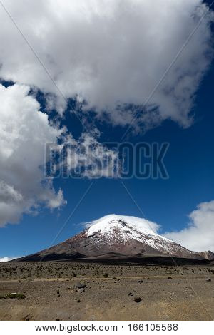 the Chimborazo volcano with cloud formations above