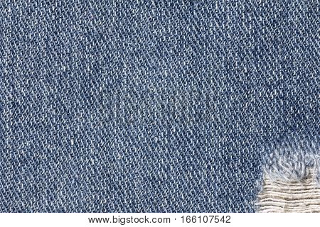 Denim jeans texture or denim jeans background with old torn. Old grunge vintage denim jeans. Stitched texture denim jeans background of fashion jeans design.